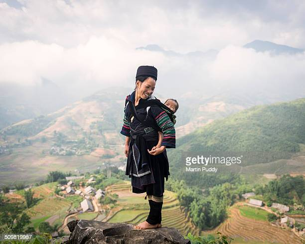 Hill tribe woman carrying baby on her back
