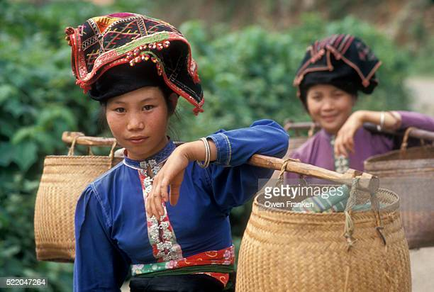 hill tribe woman carrying baskets to the market - son la stock pictures, royalty-free photos & images