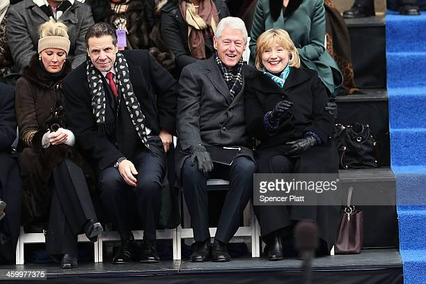 Hillary and Bill Clinton sit with New York Governor Andrew Cuomo and his girlfriend Sandra Lee as they watch ceremonies for New York City's 109th...