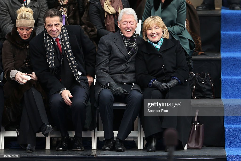 Hillary and Bill Clinton (right) sit with New York Governor Andrew Cuomo and his girlfriend Sandra Lee (left) as they watch ceremonies for New York City's 109th Mayor Bill de Blasio on January 1, 2014 in New York City. Mayor de Blasio was sworn in using a Bible once owned by President Franklin Delano Roosevelt. Following the 12 years of the Michael Bloomberg administration, Mayor de Blasio won on a liberal platform that emphasized the growing gulf between the rich and poor in New York City.