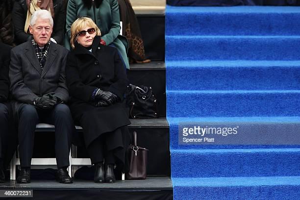 Hillary and Bill Clinton watch the ceremonies for New York City's 109th Mayor Bill de Blasio on January 1 2014 in New York City Mayor de Blasio was...