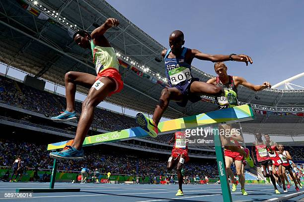 Hillary Bor of the United States and Hailemariyam Amare of Ethiopia compete in round one of the Men's 3000m Steeplechase on Day 10 of the Rio 2016...