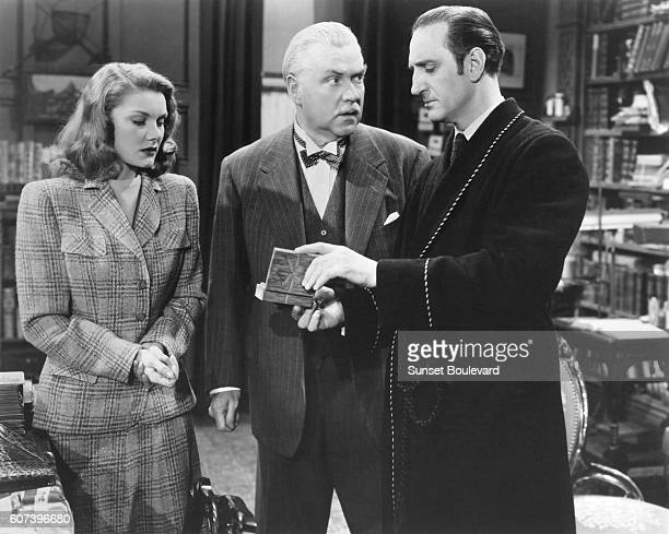 Hillary Brooke Nigel Bruce Basil Rathbone on the set of 'The Woman in Green'