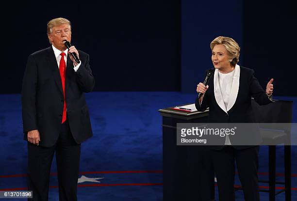 Hillary Clinton 2016 Democratic presidential nominee and Donald Trump 2016 Republican presidential nominee speak during the second US presidential...