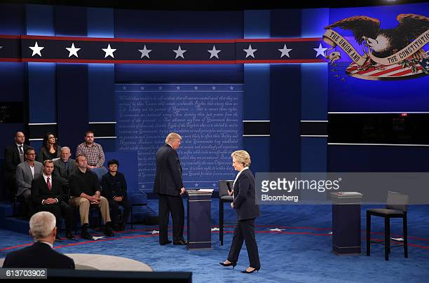 Hillary Clinton 2016 Democratic presidential nominee and Donald Trump 2016 Republican presidential nominee stand on stage during the second US...