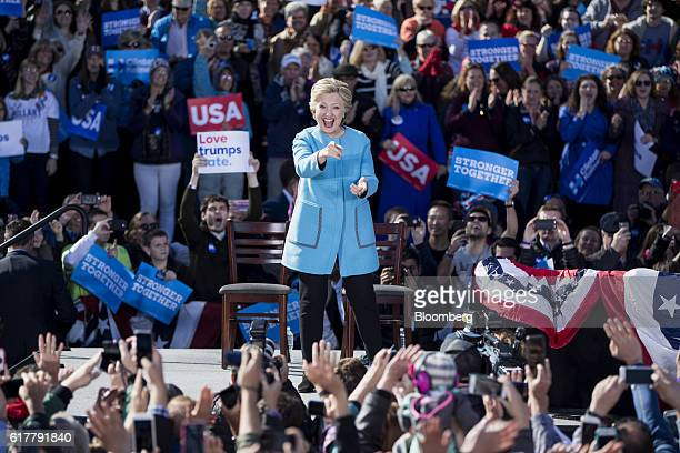 Hillary Clinton 2016 Democratic presidential nominee gestures after speaking during a campaign event in Manchester New Hampshire US on Monday Oct 24...
