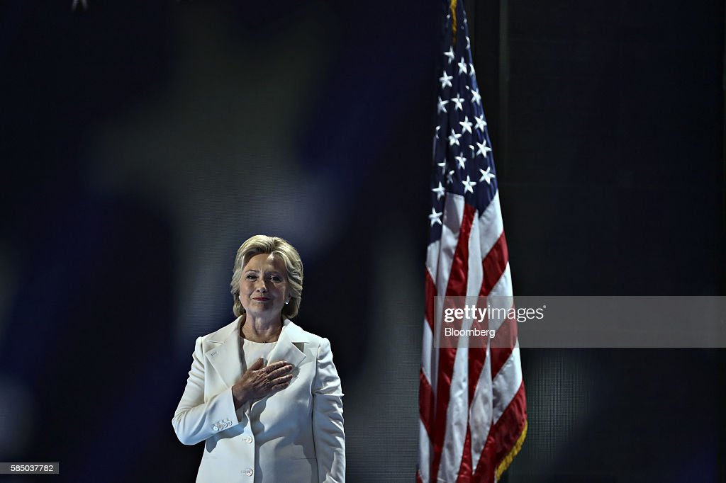 Hillary Clinton, 2016 Democratic presidential nominee, holds a hand over her heart while arriving to speak during the Democratic National Convention (DNC) in Philadelphia, Pennsylvania, U.S., on Thursday, July 28, 2016. Division among Democrats has been overcome through speeches from two presidents, another first lady and a vice-president, who raised the stakes for their candidate by warning that her opponent posed an unprecedented threat to American diplomacy. Photographer: Andrew Harrer/Bloomberg via Getty Images