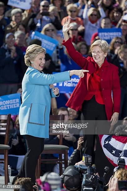 Hillary Clinton 2016 Democratic presidential nominee left and Senator Elizabeth Warren a Democrat from Massachusetts gesture while taking the stage...