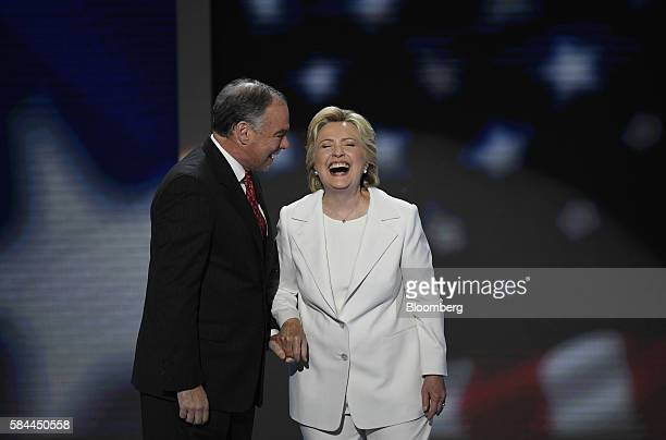 Hillary Clinton 2016 Democratic presidential nominee right laughs on stage with Tim Kaine 2016 Democratic vice presidential nominee during the...