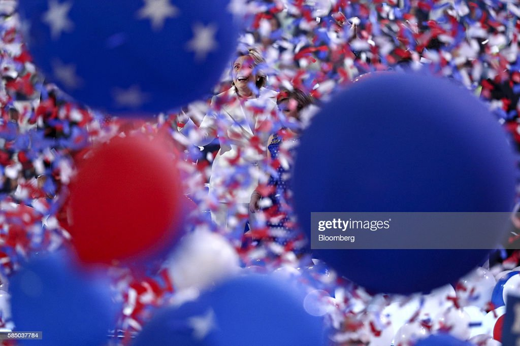 Hillary Clinton, 2016 Democratic presidential nominee, smiles as balloons and confetti fall on stage during the Democratic National Convention (DNC) in Philadelphia, Pennsylvania, U.S., on Thursday, July 28, 2016. Division among Democrats has been overcome through speeches from two presidents, another first lady and a vice-president, who raised the stakes for their candidate by warning that her opponent posed an unprecedented threat to American diplomacy. Photographer: Andrew Harrer/Bloomberg via Getty Images