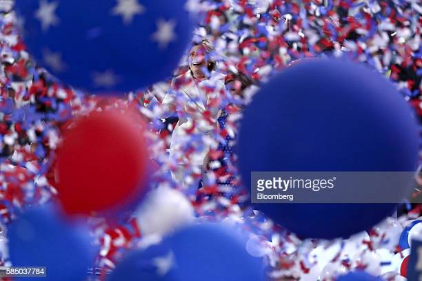 Hillary Clinton 2016 Democratic presidential nominee smiles as balloons and confetti fall on stage during the Democratic National Convention in...