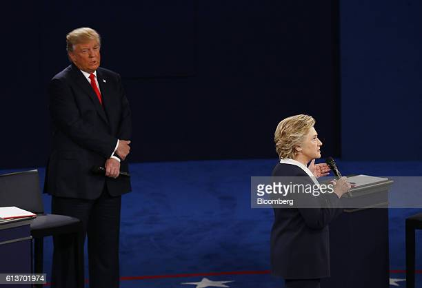 Hillary Clinton 2016 Democratic presidential nominee speaks as Donald Trump 2016 Republican presidential nominee stands during the second US...