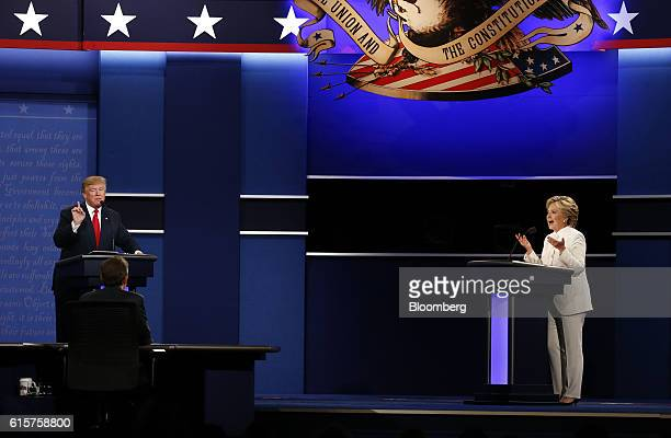 Hillary Clinton 2016 Democratic presidential nominee speaks as Donald Trump 2016 Republican presidential nominee gestures during the third US...
