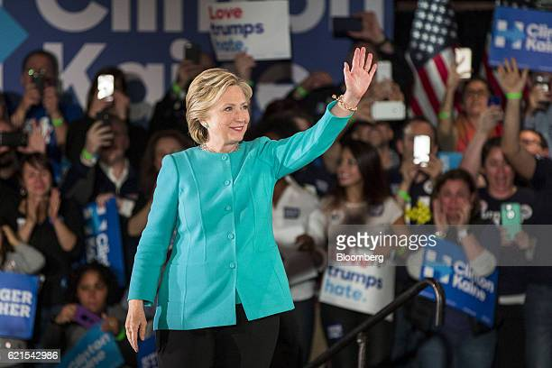 Hillary Clinton 2016 Democratic presidential nominee waves during a campaign rally in Manchester New Hampshire US on Sunday Nov 6 2016 Clinton's...