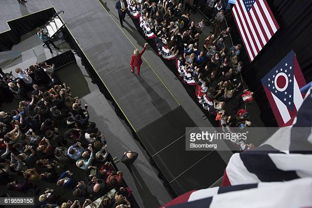 Hillary Clinton 2016 Democratic presidential nominee waves to attendees while arriving on stage during a campaign event in Cleveland Ohio US on...