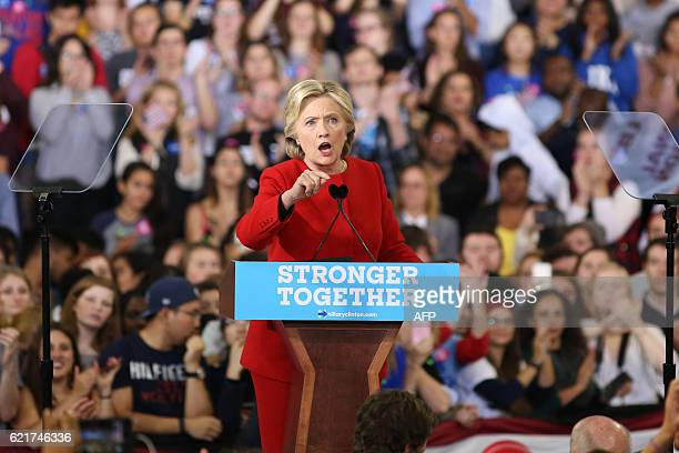 Hillary Clinton address the crowd inside the Reynolds Coliseum on the campus of North Carolina State University for the final campaign stop before...