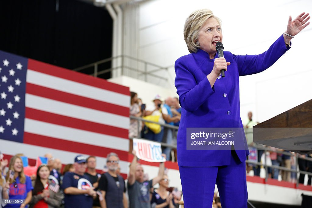 Hillary Clinton addresses supporters at Long Beach City College on the final day of California campaigning, June 6, 2016 in Long Beach, California. Hillary Clinton has received commitments from enough delegates to clinch the Democratic presidential nomination, according to the Associated Press and US networks, ensuring she will be the first woman to lead a major US party in the race for the White House. / AFP / JONATHAN
