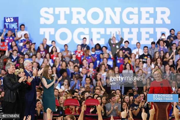 TOPSHOT Hillary Clinton addresses the crowd of supporters inside the Reynolds Coliseum on the campus of North Carolina State University on the final...