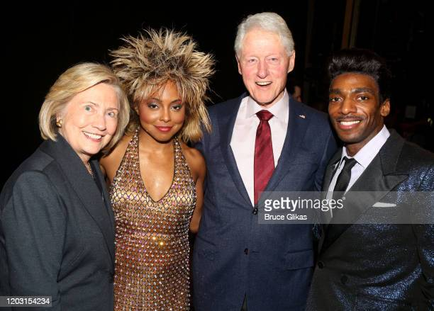 """Hillary Clinton, Adrienne Warren as """"Tina Turner"""", Bill Clinton and Daniel J Watts as """"Ike Turner"""" pose backstage at the hit musical """"TINA – The Tina..."""