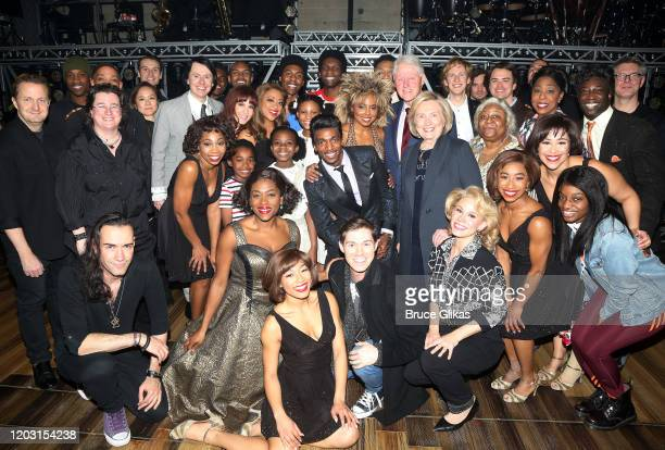 """Hillary Clinton and Bill Clinton pose with Adrienne Warren as """"Tina Turner"""" and the cast & band backstage at the hit musical """"TINA – The Tina Turner..."""