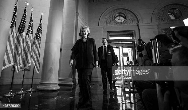 Hillary Clinton arrives at Longworth House Office Building to testify before the House Committee on Benghazi attacks on October 22, 2015 in...