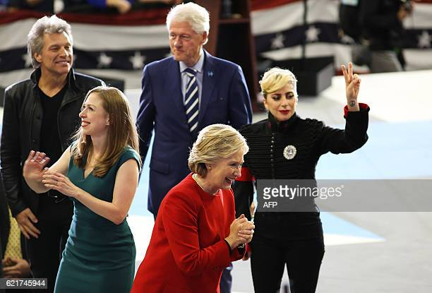 Hillary Clinton Chelsea Clinton Bill Clinton Lady Gaga and Jon Bon Jovi greet the crowd as they walk off stage inside the Reynolds Coliseum on the...