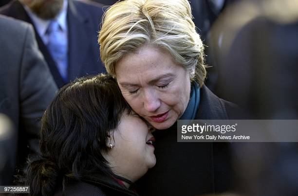 Hillary Clinton comforts Maren Sarkar who lost her husband an engineer for the Port Authority at a memorial for family members at the site of the...