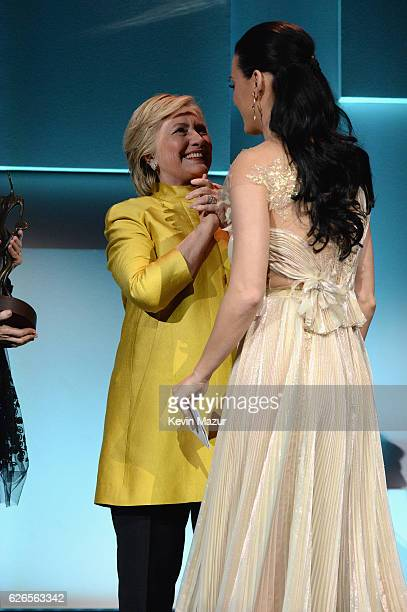 Hillary Clinton congratulates Katy Perry on stage during the 12th annual UNICEF Snowflake Ball at Cipriani Wall Street on November 29 2016 in New...