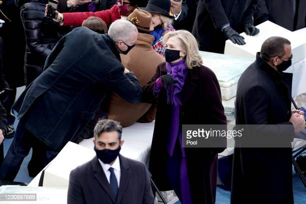 Hillary Clinton elbow bumps Rep. Sean Maloney prior to the 59th Presidential Inauguration on January 20, 2021 in Washington, DC. During today's...