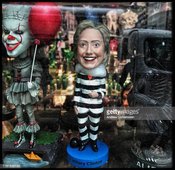 A Hillary Clinton figure dressed in prison clothes is on display for sale at a tourist shop on October 29 2019 in midtown Manhattan New York City