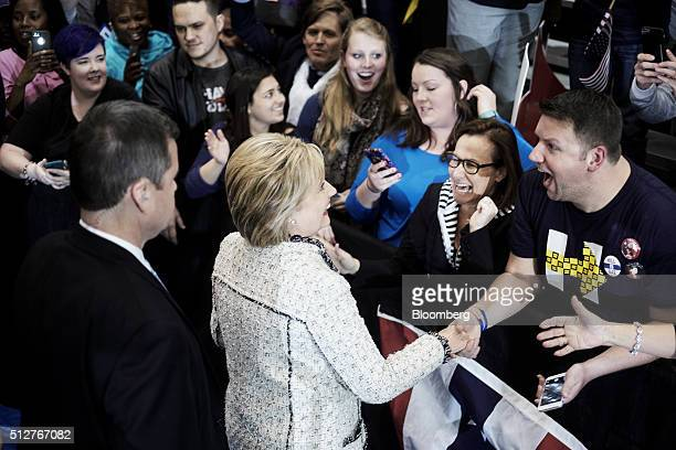 Hillary Clinton former Secretary of State and 2016 Democratic presidential candidate center greets attendees during a primary election night rally at...