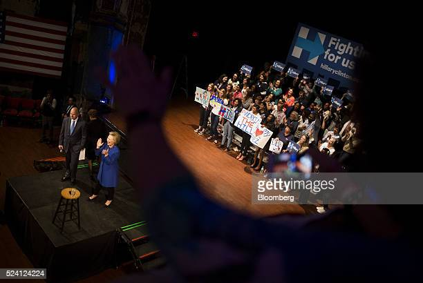 Hillary Clinton former Secretary of State and 2016 Democratic presidential candidate applauds during a campaign event in Wilmington Delaware US on...