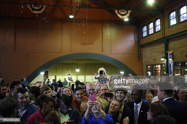 Hillary Clinton former Secretary of State and 2016 Democratic presidential candidate center takes a selfie photograph with attendees after speaking...