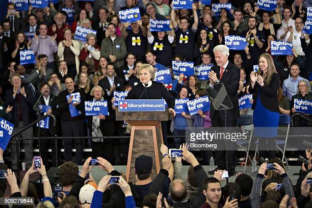 Hillary Clinton former Secretary of State and 2016 Democratic presidential candidate center pauses as her husband Bill Clinton former US president...