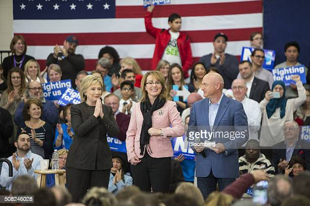 Hillary Clinton former Secretary of State and 2016 Democratic presidential candidate left stands on stage with Gabrielle Giffords former US...