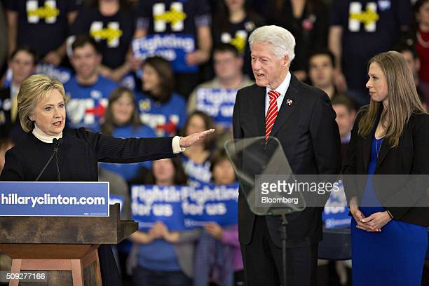 Hillary Clinton former Secretary of State and 2016 Democratic presidential candidate left to right speaks as her husband Bill Clinton former US...
