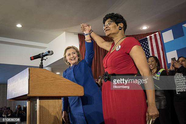 Hillary Clinton, former Secretary of State and 2016 Democratic presidential candidate, left, steps on stage with Geneva Reed-Veal, mother of Sandra...