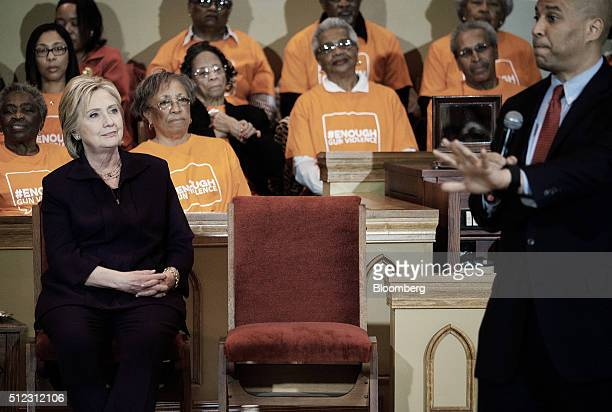 Hillary Clinton former Secretary of State and 2016 Democratic presidential candidate left listens as Senator Cory Booker a Democrat from New Jersey...