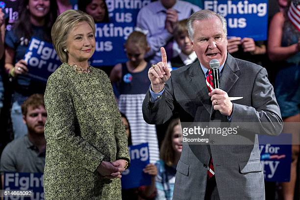 Hillary Clinton former Secretary of State and 2016 Democratic presidential candidate left listens while being introduced by Bob Buckhorn mayor of...
