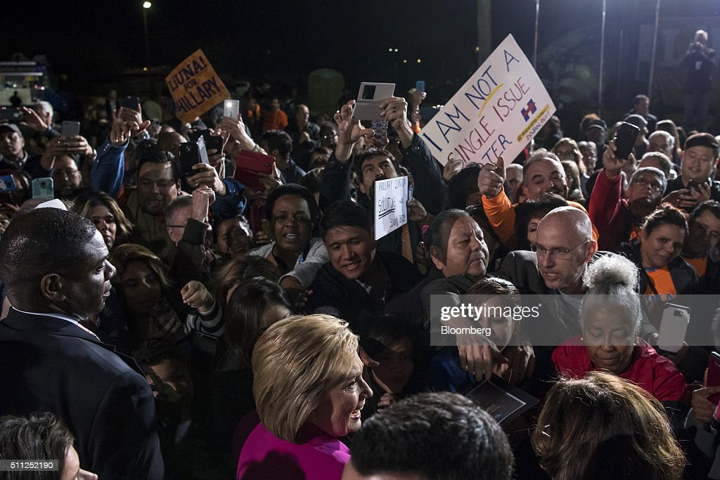 Hillary Clinton, former Secretary of State and 2016 Democratic presidential candidate, foreground center, greets supporters during a campaign rally at the Laborers International Union in Las Vegas, Nevada, U.S., on Thursday, Feb. 18, 2016. Polling suggests Clinton is in danger of being overtaken by Sanders, a Vermont senator and self-described democratic socialist when the Nevada caucuses are held on February 20. Photographer: David Paul Morris/Bloomberg via Getty Images