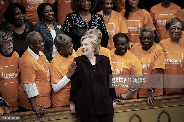 Hillary Clinton former Secretary of State and 2016 Democratic presidential candidate center speaks with attendees while standing for a photograph...