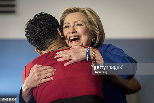 Hillary Clinton, former Secretary of State and 2016 Democratic presidential candidate, right, hugs Geneva Reed-Veal, mother of Sandra Bland during a...