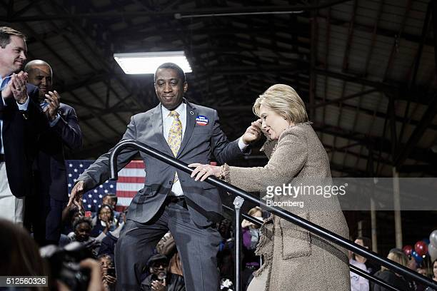 Hillary Clinton former Secretary of State and 2016 Democratic presidential candidate right arrives on stage to speak during a town hall event at the...