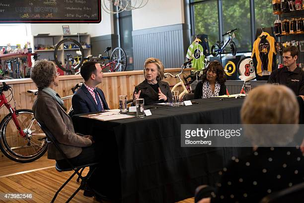 Hillary Clinton former secretary of state and US presidential candidate center speaks during a small business roundtable discussion with Donna...