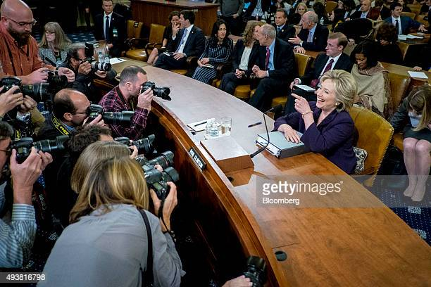 Hillary Clinton former US secretary of state and 2016 Democratic presidential candidate jokes with photographers as she prepares to resume her...