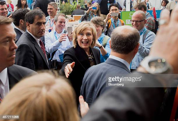 Hillary Clinton, former U.S. Secretary of state, center, greets attendees during the DreamForce Conference in San Francisco, California, U.S., on...