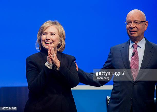 Hillary Clinton, former U.S. Secretary of state, left, smiles while on stage with Klaus Schwab, chairman of the World Economic Forum , during the...