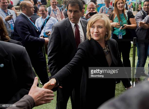 Hillary Clinton, former U.S. Secretary of state, right, greets attendees during the DreamForce Conference in San Francisco, California, U.S., on...