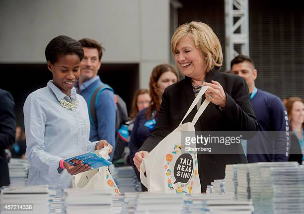 Hillary Clinton, former U.S. Secretary of state, right, helps fill tote bags with items for new parents during the DreamForce Conference in San...