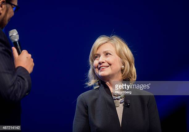 Hillary Clinton, former U.S. Secretary of state, right, listens as Marc Benioff, chairman and chief executive officer of Salesforce.com Inc., speaks...